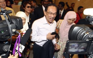 Malaysian opposition leader Anwar Ibrahim, center, arrives at court house in Putrajaya, Malaysia Tuesday, Feb. 10, 2015. Malaysia's top court on Tuesday upheld Anwar's sodomy conviction in a case seen at home and aboard as politically motivated to eliminate any threats to the government. (AP Photo) MALAYSIA OUT