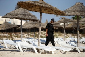 Police officers patrol the beach near the RIU Imperial Marhaba hotel in Sousse, Tunisia, where 38 people lost their lives after a gunman stormed the beach. PRESS ASSOCIATION Photo. Picture date: Friday July 3, 2015. Britain will remember the victims of the Tunisia terror attack with a minute's silence today. See PA story POLICE  Tunisia. Photo credit should read: Steve Parsons/PA Wire Lapresse Only italyAttacco terroristico a Sousse - La situazione dopo l'attentato