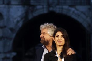 In this photo taken Saturday, Nov 26, 2016, Rome Mayor Virginia Raggi and 5-Star Movement leader Beppe Grillo attend a political rally in Rome. Raggi vowed Friday to continue her administration following the arrest in a corruption probe of a top City Hall official that dealt another blow to the populist 5-Star Movement's highest profile office holder. (ANSA/AP Photo/Gregorio Borgia) [CopyrightNotice: Copyright 2016 The Associated Press. All rights reserved.]