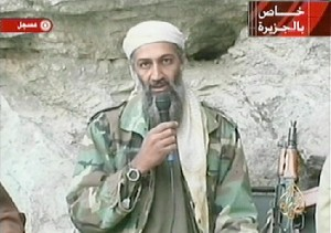 "AFGHANISTAN:Saudi-born alleged terror mastermind Osama bin Laden is seen in this video footage recorded ""very recently"" at an undisclosed location in Afghanistan aired by the Qatar-based satelite TV station al-Jazeera 07 October 2001. Retaliatory strikes against Afghanistan began 07 October with US and British forces bombing terrorist camps, air bases and air defense installations in the first stage of its campaign against the Taliban regime for sheltering bin Laden, who is the ""prime suspect"" in the 11 September attacks in the US. Al-Jazeera reported that the video was shot to be broadcast after the first US bombings. AFP PHOTO/AL-JAZEERA (Photo credit should read AFP/Getty Images)"